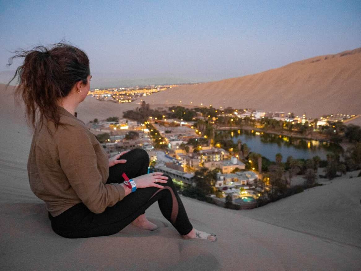 Looking down at Huacachina from the sand dunes