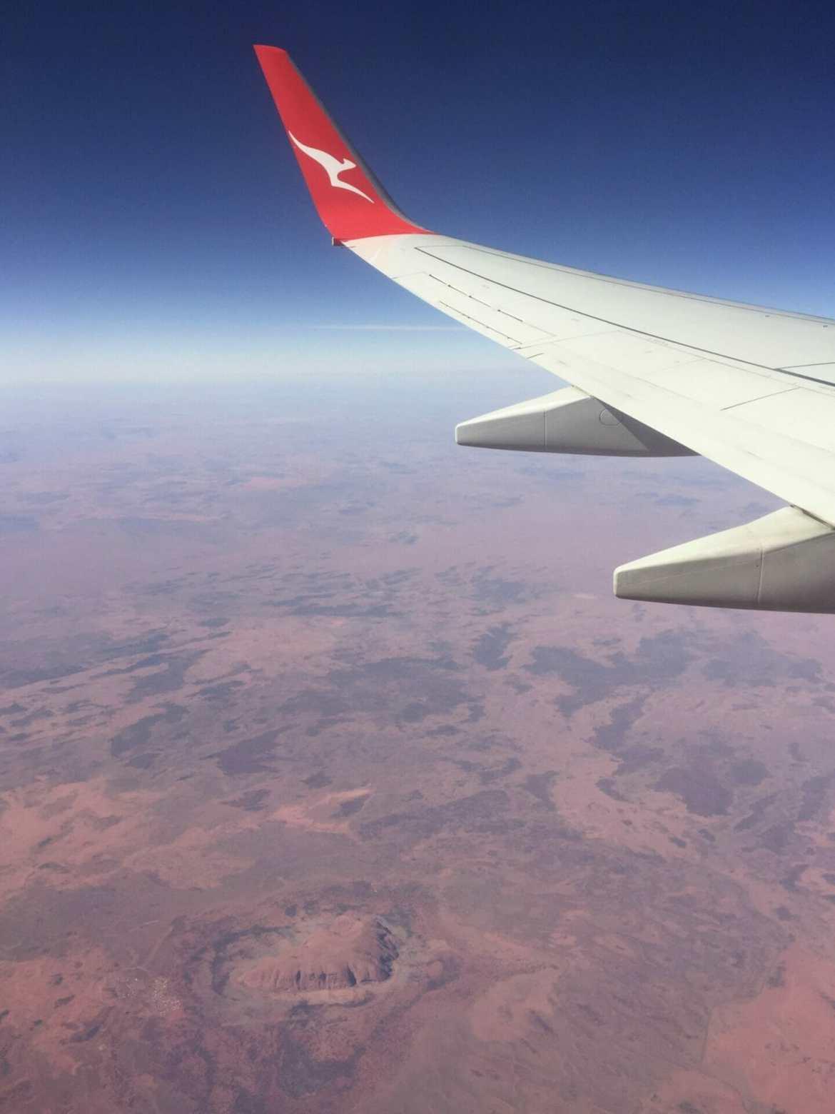 Qantas plane over Uluru Australia