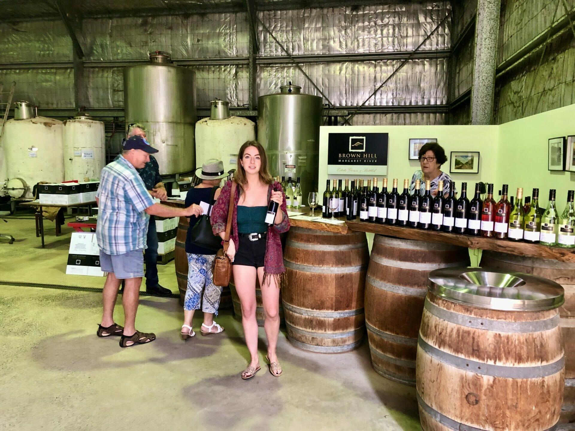 Girl at wine cellar door Margaret River Western Australia