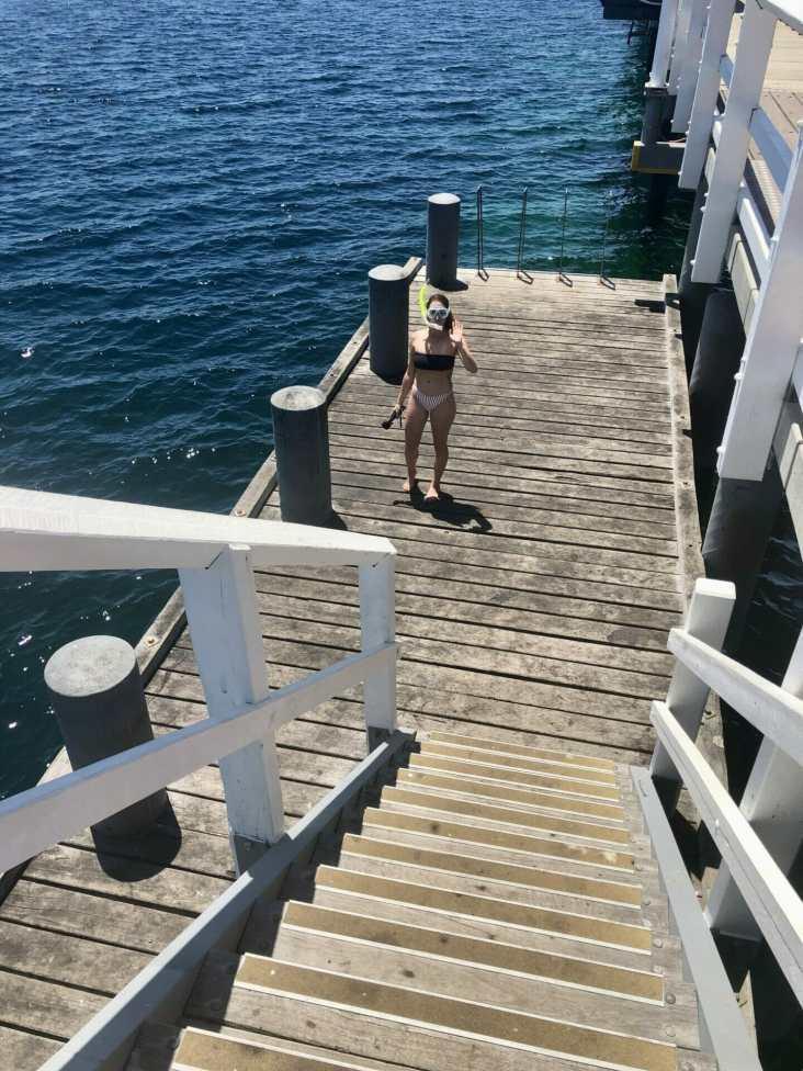 Girl snorkelling Busselton Jetty Perth Western Australia