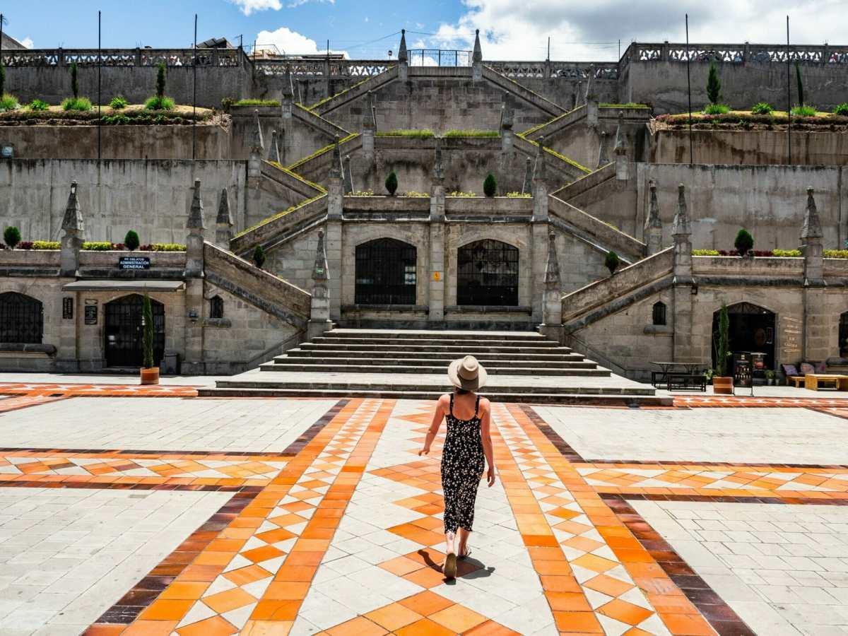 Girl walking through colourful courtyard at Basílica del Voto Nacional in Quito