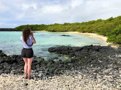Girl taking photo of beach Isla Isabela