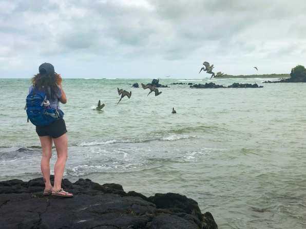 Girl taking photo of birds at Mirador Los Tunes