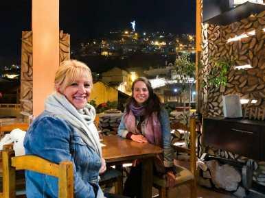 Women sitting at Leña Quiteña in La Ronda
