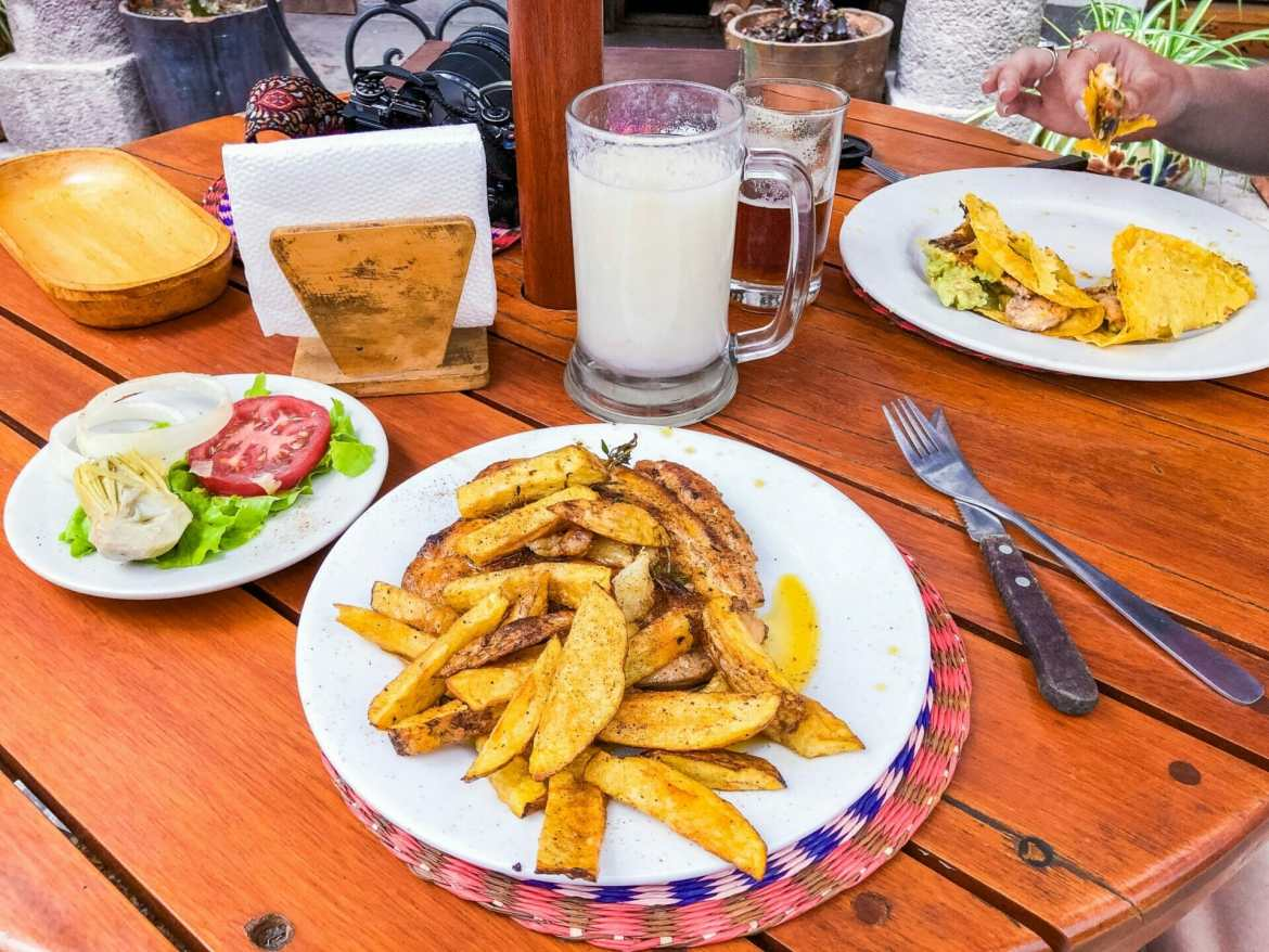 Chicken and potato on table at cafe in Quito