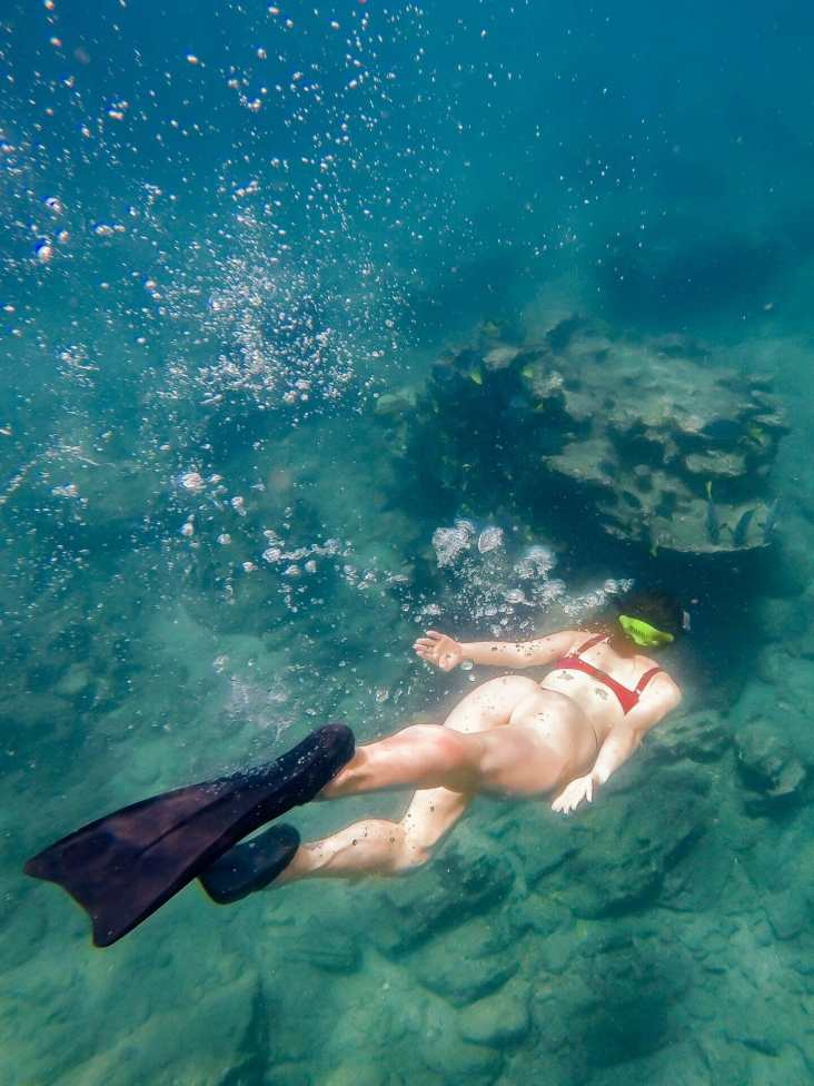 Girl snorkelling in Galápagos
