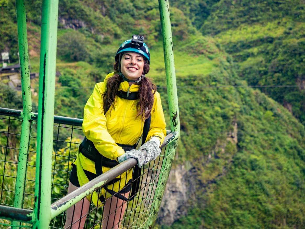 Girl smiling in cable car Baños Ecuador