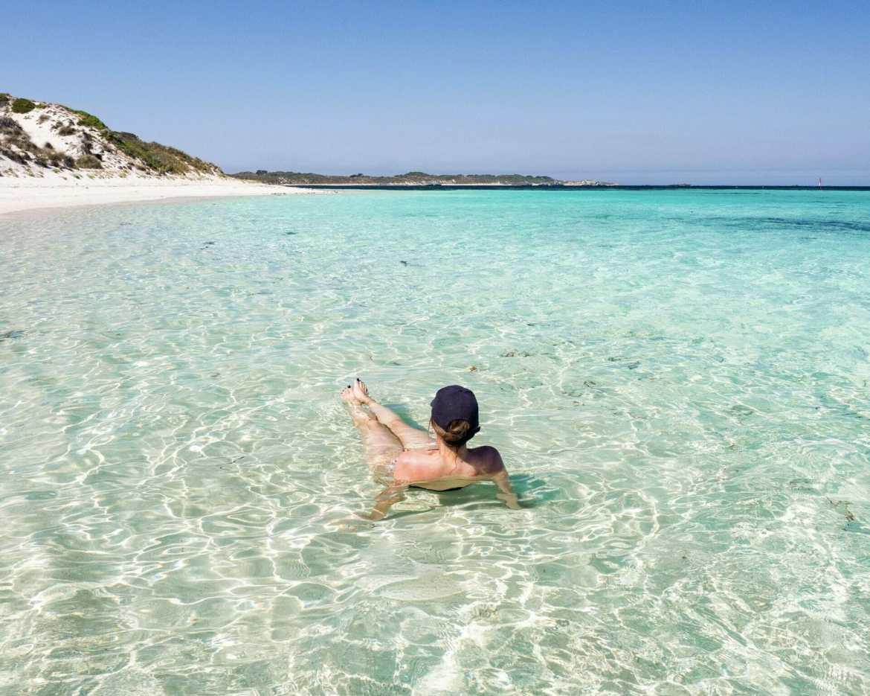 Girl in water beach Rottnest Island Western Australia