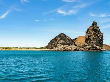 Pinnacle Rock rising out of the ocean Galápagos