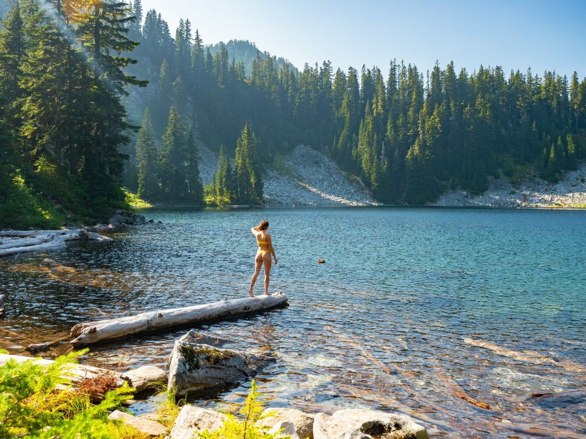 Girl swimming in Alpine Lakes Wilderness