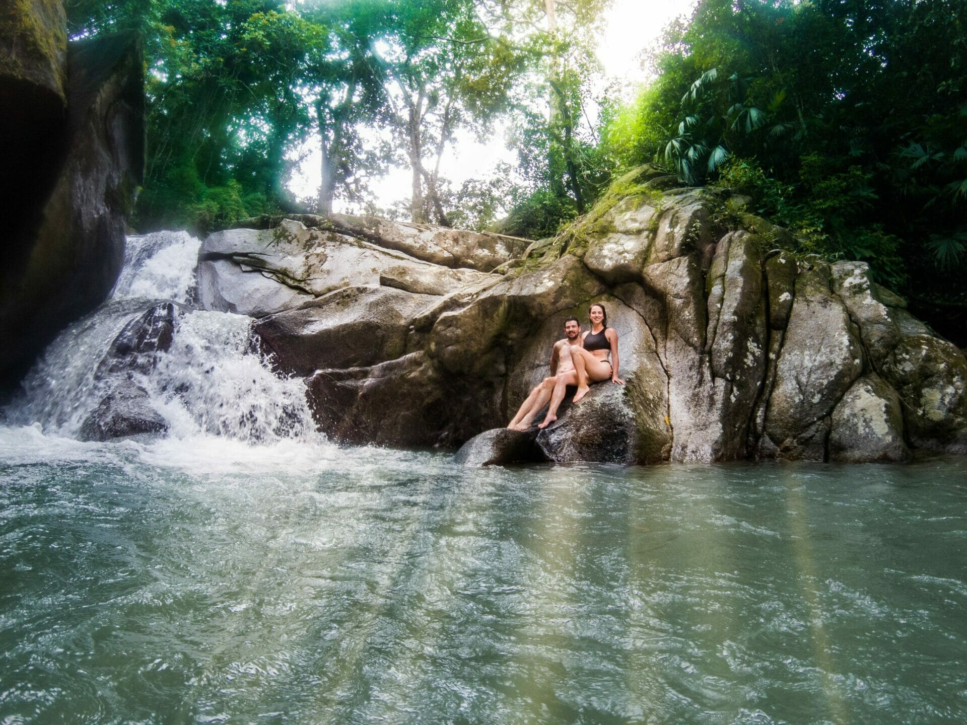 couple swimming waterfall Minca Colombia