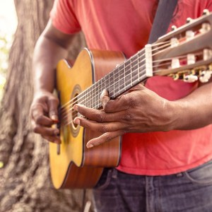 Think There Could Be More To Life? There Is! - Man holding guitar