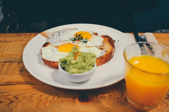 keepin it simple with avocado and egg toast with a side of fresh orange juice