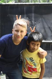 Clayton having fun with a Guatemalan boy