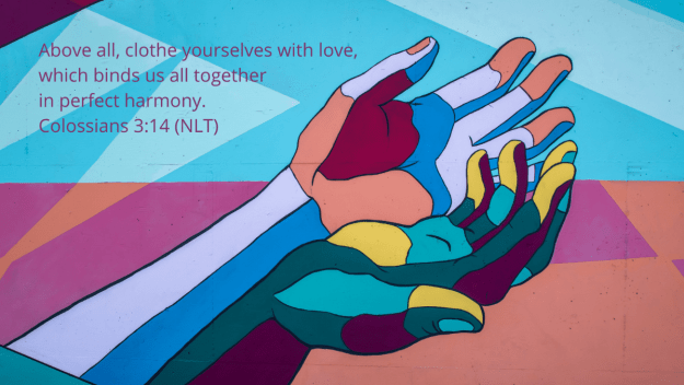 multi-color mural of open hands with quotation of Colossians 3:14, NLT