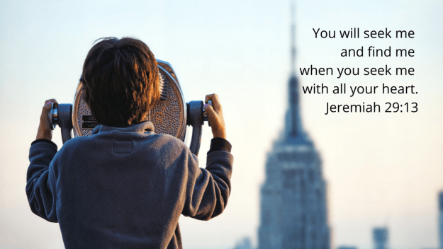 Boy looking through telescope at the Empire State Building with quotation of Jeremiah 29:11-13, NIV