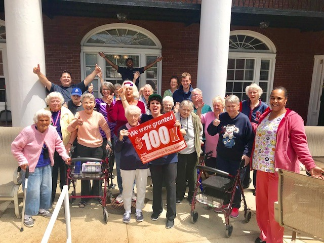 Residents and staff celebrate our $100,000 Cummings Foundation Grant