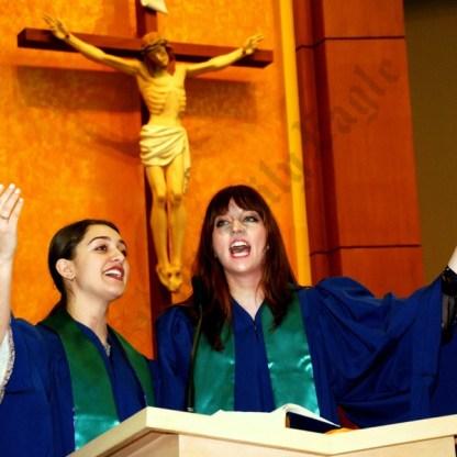 Hymns were preformed by the Saint Bernard Choir. Samantha Blafford and Briana Sky Riley perform. - Brooklyn Archive