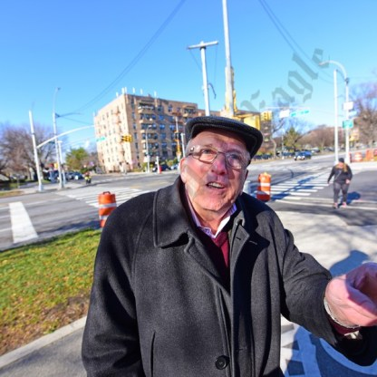 Area resident George Weill points out how difficult traveling through Midwood will become if the NYSDOT changes come into play. - Brooklyn Archive
