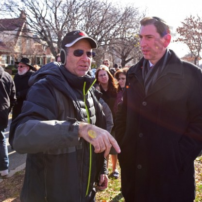 Mike Wright points out particularities of the neighborhood to NYC Council Member Chaim Deutsch. - Brooklyn Archive