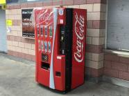 A Coca Cola machine on the concourse.