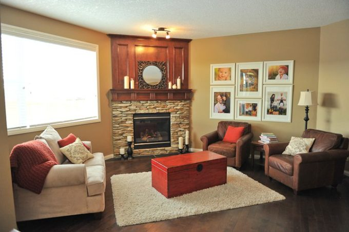 Arranging furniture with a corner fireplace brooklyn for Family room furniture layout tv fireplace