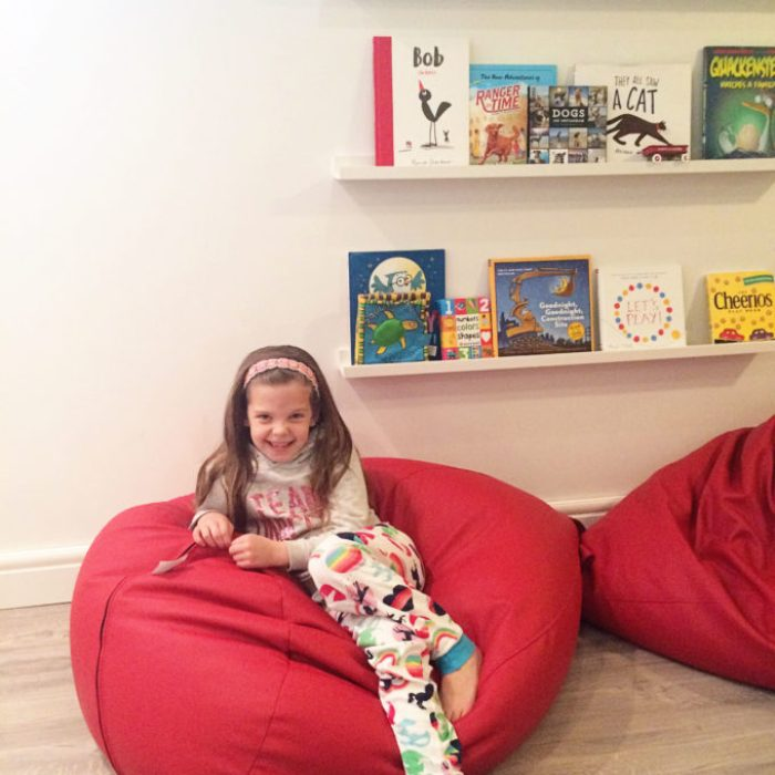 Bright Basement Playroom Reveal - book ledges and leather bean bags