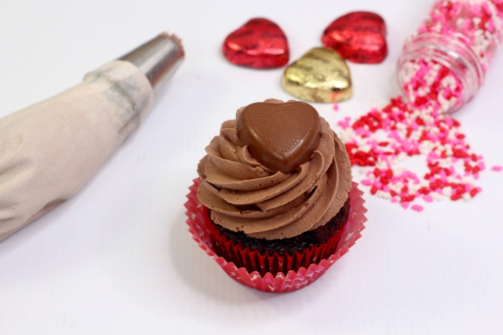 Valentines Day Chocolate Peanut Butter cupcakes with heart sprinkles.