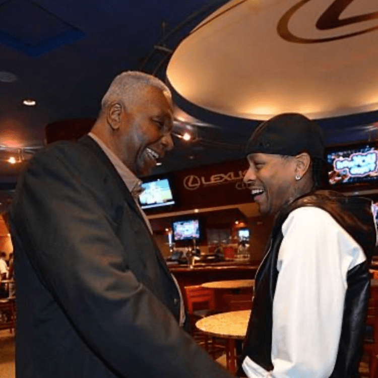 Coach John Thompson and NBA Hall of Famer Allen Iverson sharing a laugh.