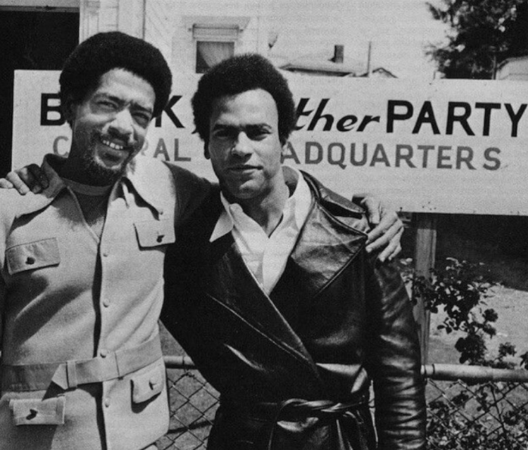 Black Panther Party founders Bobby Seal and Dr. Huey P. Newton in front of the official Black Panther Party headquarters
