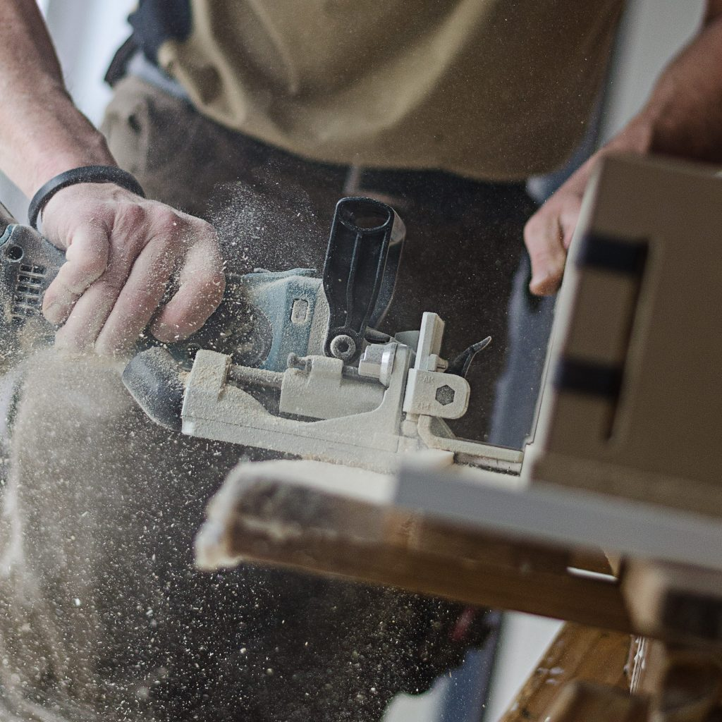 A picture of someone using an electric sander