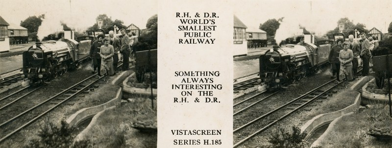A view depicting a group of elderly tourists standing next to a tiny steam locomotive in motion.
