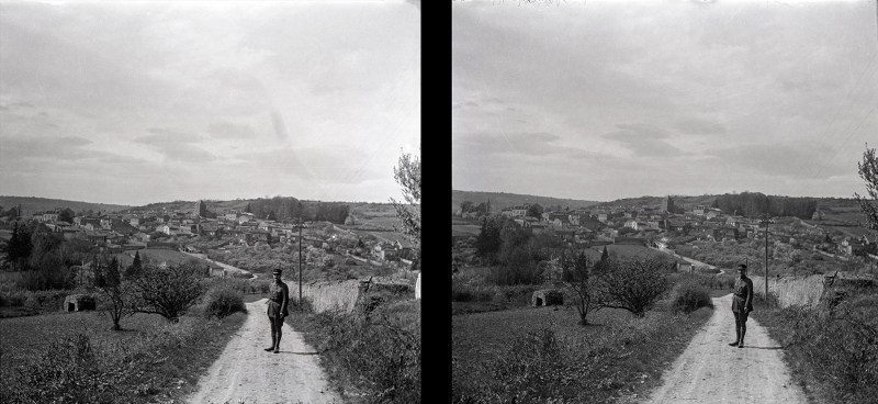 An image of a soldier standing in the middle of a long and winding road, with fields to both sides. Never before posted on Brooklyn Stereography.