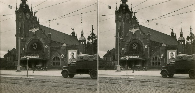 A photograph of the railway station in Danzig (the German name for Gdansk) showing Nazi adornments, including a giant picture of Adolf Hitler. N.B. Brooklyn Stereography does not condone Nazism in any form.