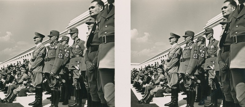 Hitler and his cohorts stand on a platform, majestically looking out at the crowd. N.B. Brooklyn Stereography does not condone Nazism in any form.