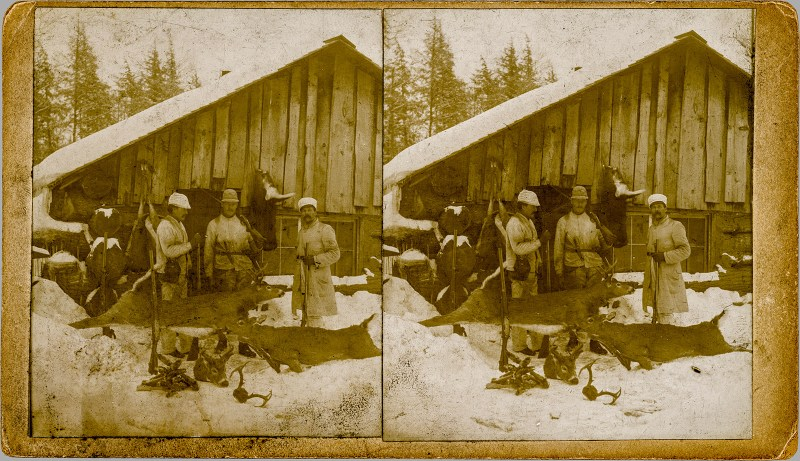 Some hunters gathered outside a barn with their kills. Handmade view. Found in a Strasburg antique shop. Digitally cleaned up by myself.