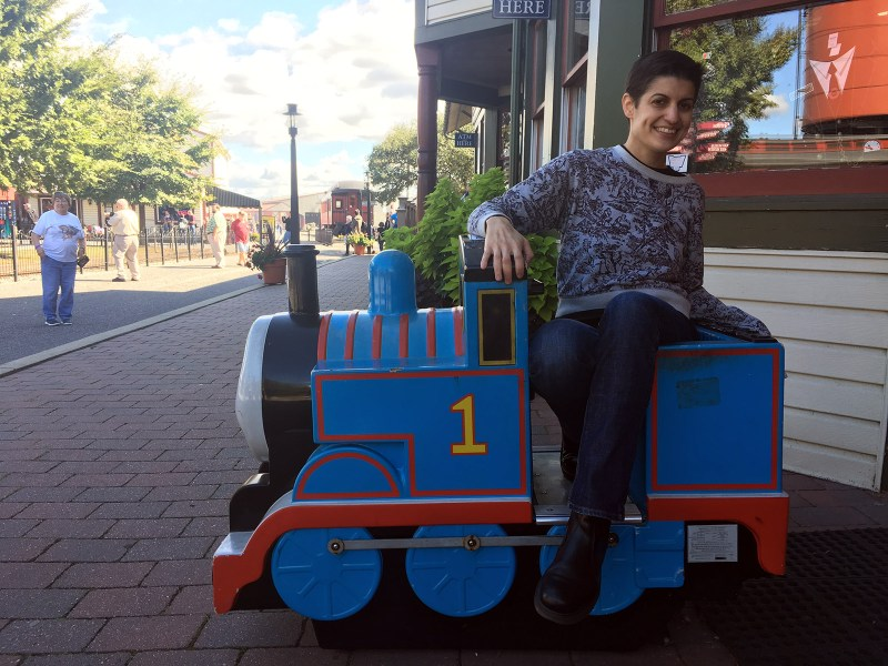 My wife seated atop a kiddie locomotive at the Strasburg Rail Road