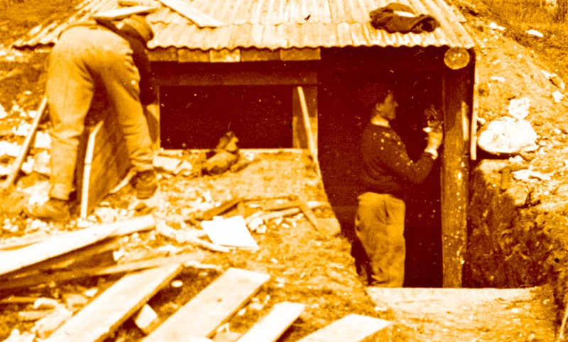 Detail from the above amateur glass stereoview; the man inside the shelter is clearly utilizing a hammer.