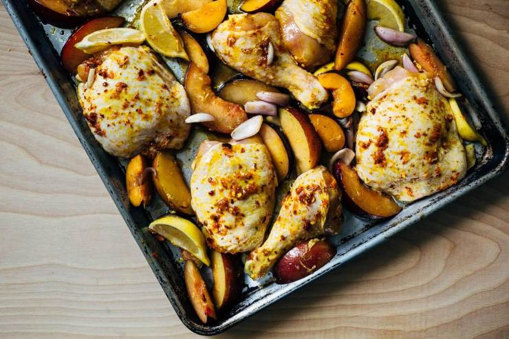 A simple sheet pan chicken and plums recipe featuring crispy saffron- and garlic-infused chicken topped with a sweet and savory plum pan sauce.