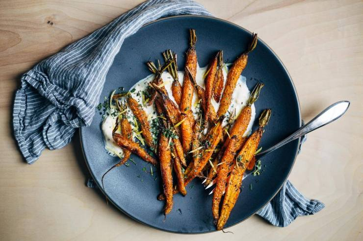 An autumnal roasted carrot salad recipe with cracked pepper and cumin crème fraîche.