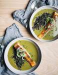 Nourishing green soup with creamy coconut milk and wild rice topped with a pan-seared salmon fillet.