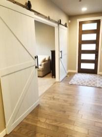 custom painted barn doors complete the first floor office/5th bedroom