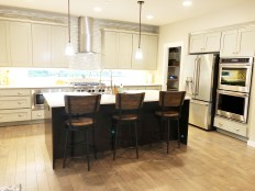 Chefs kitchen with double ovens, farmhouse sink, backyard viewpoint window and expansive walk in pantry
