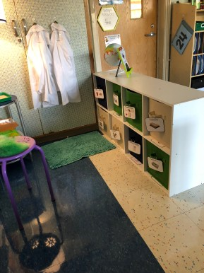 A sideview of a Makerspace equipped with manipulatives and white lab coats.