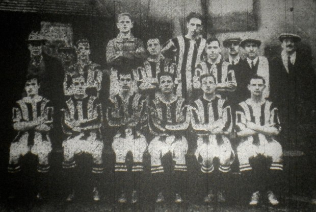 Brownhills Town 1921 (left to right) Back row: Adams (injured), Wilkes (Goalkeeper), Gregory, I. Humphries (Committeeman) Second Row: W. E. Cooper (secretary), Jones, Cooper, E. Lowe, Madhan (Trainer) and J. Brown Front row: W. Cooper, W. Biggins, Davis, Ellis, Shingler, Cole.