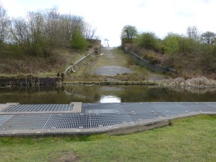 The complex and modern canal overflow is part of the 'new' system, the overflow itself being slightly to the side of the drain culvert beneath, which is central to the brick sluice, as indicated by access covers.