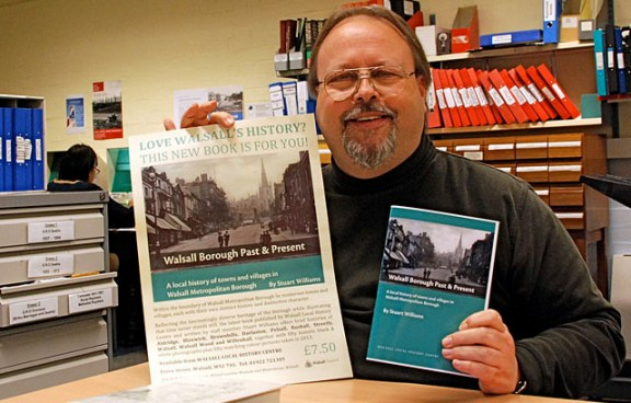 Stuart-Williams-with-a-proof-copy-of-his-new-book-and-a-poster-640-2
