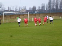 A dramatic penalty save by the home goalkeeper. Image kindly supplied by David Evans.