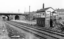 Posted by Si Swain on Facebook who says 'The scene of dereliction at Brownhills (LNWR) station in 1967. Passenger services had ended 2 years earlier but freight traffic was still running at this time. The station yard has lost it's track and the signal box is devoid of nameboards and windows. Through the High Street overbridge the canopy of the Up station buildings and weed strewn platform can be seen. View looking towards Hammerwich and Lichfield. Copyright unknown.'