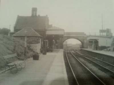 Posted by Si Swain on Facebook who says 'This view dates from April 1957 and shows the station buildings and bridge well. The large building in the top right was Brownhills town hall. Through the bridge can be seen the goods yard which closed on 10th April 1964 and the signal box which closed on 23rd January 1967. Copyright H.C Casserley'